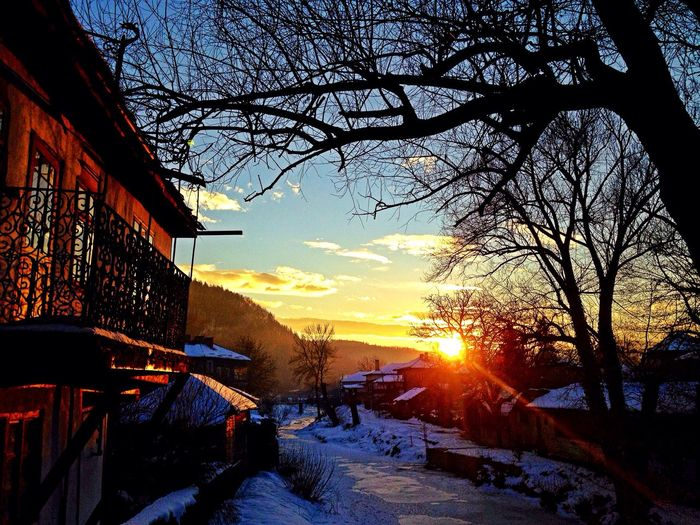 Tryavna,Bulgaria ❄️😍😇 Tree Sunset Sky Bare Tree Winter Snow Cold Temperature Built Structure Nature Silhouette Building Exterior No People Outdoors Beauty In Nature Branch Sun Architecture Sunbeam Day Night IPhoneography IMography Tryavna Bulgaria Nature Shades Of Winter