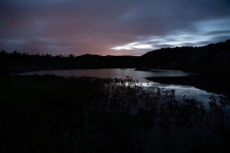 Tjoatjørn in the red Tjoatjørn Beauty In Nature Cloud - Sky Dark Idyllic Lake Long Exposure Nature Night No People Non-urban Scene Outdoors Reflection Scenics - Nature Sky Tranquil Scene Tranquility Tree Water