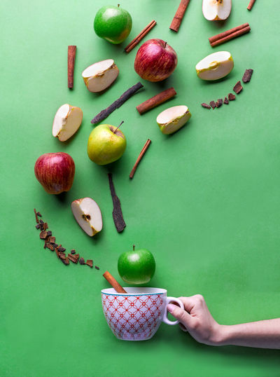 Colors Food And Drink Fun Happy Tea Apple - Fruit Color color palette Color Photography Colorful Food Food And Drink Food Photography Freshness Fruit Green Background Green Color Happy Time Healthy Eating High Angle View Human Hand Large Group Of Objects Studio Shot Tea Cup Tea Time