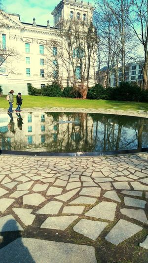 Reflection Architecture Sky Building Exterior Built Structure Outdoors Men Real People People Day Tree Water City Public Transportation Travel Transportation