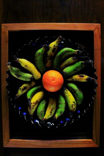 Bowl-ing (with local fruit)! Banana Beautifully Organized Black Background Blue Bowl Bowl Of Fruit Close-up Day Directly Above Food Food And Drink Framed Freshness Fruit Healthy Eating Illusion Indoors  No People Orange-fruit Yellow Break The Mold Visual Feast Summer Exploratorium