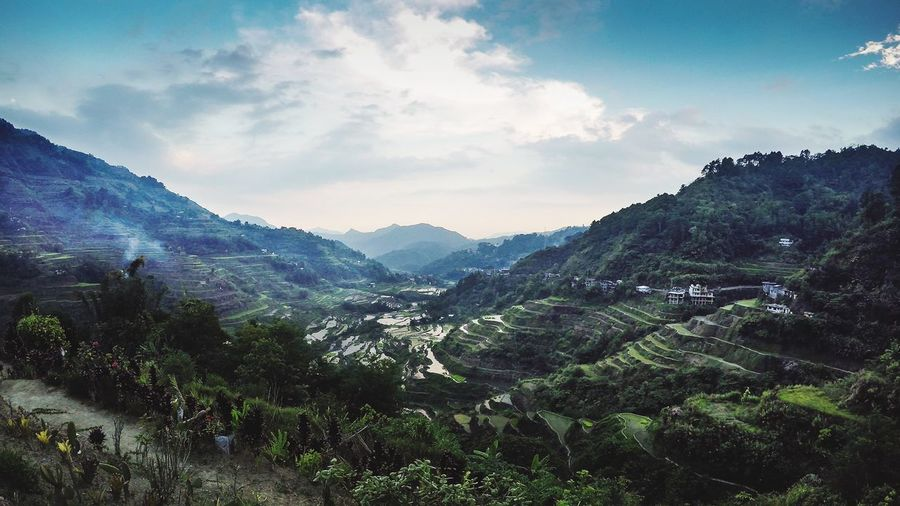 Scenic View Of Rice Terraces Against Cloudy Sky