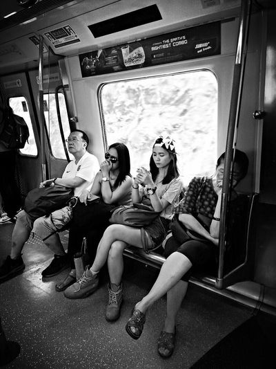 When we are Riding the MTR and my friend was Setting and didn't know i have captured a photo of her... MTR Hong Kong Hanging Out Enjoyingtime Offday That's Me Taking Photos BW_photography Cheese! 😂✌
