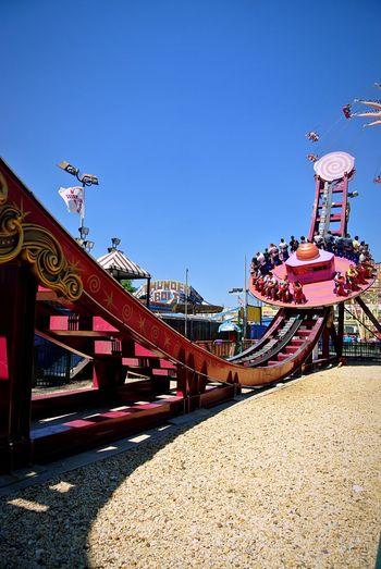 Riding Roller Coasters Roller Coaster Rollercoaster Ride Amusementpark Amusement  Funfair Theme Park Themepark Adrenaline Junkie Beach Sand Sky The Tourist Shadow Shadows & Lights Colors Of Carnival Adrenaline AdrenalineRush Thrill Rides Thrillseeker Thrill Red Rollercoaster Rollercoasters Pastel Power