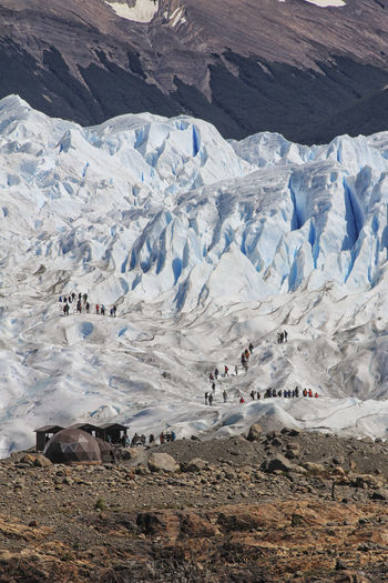 Glacier Trekking Snow Mountain Cold Temperature Winter Landscape Environment Beauty In Nature Scenics - Nature Nature Day Land Non-urban Scene Tranquil Scene Ice Mountain Range Tranquility Adventure Snowcapped Mountain Outdoors Tourist Destination Tourists People Real People