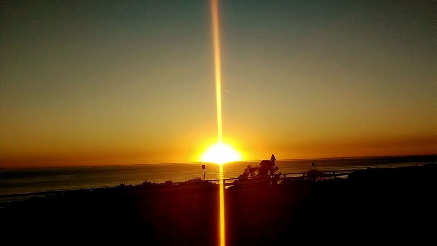 Straight Lines Sunset Sea Sun Water Horizon Over Water Sunlight Silhouette Sky Nature Scenics Beach Nautical Vessel Beauty In Nature Outdoors No People Vapor Trail Day Oil Pump Perspectives On Nature California Dreamin
