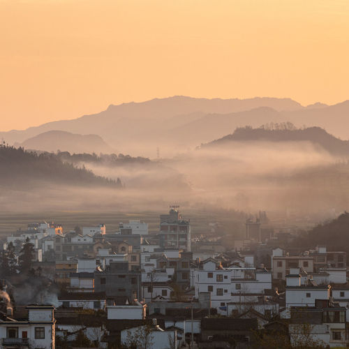 Scenic view of townscape during sunrise