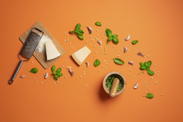 High angle view of bread on table against orange background