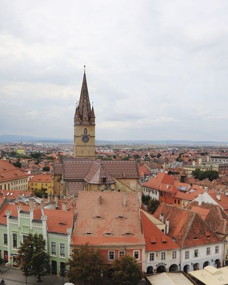 Sibiu Clock Tower Clocktowers Building Exterior Architecture Built Structure Building City Sky Tower Spirituality No People Place Of Worship Nature Religion Cityscape Belief Cloud - Sky Residential District Roof Day Outdoors Spire
