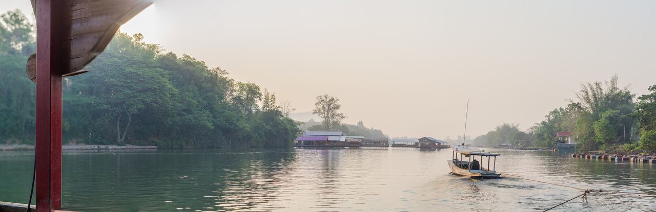 Water Nautical Vessel Transportation Mode Of Transportation Tree Plant Nature Sky Waterfront River Day Beauty In Nature Scenics - Nature Travel Reflection Outdoors Ferry on the move No People Passenger Craft Kanchanaburi Thailand