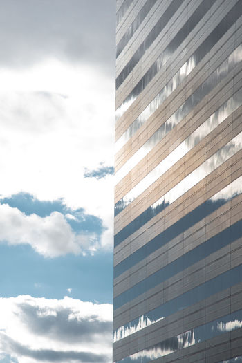 Architecture Built Structure Low Angle View Building Exterior Building No People Day City Glass - Material Outdoors Window Office Building Exterior Cloud - Sky Sky Office Modern Tall - High Skyscraper Business Reflection Fragile Sunny Geometric Shape