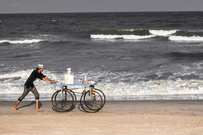 push it. Arabian Sea Beach Bestedit Bicycle Cart Foodporn Horizon Over Water Keepgoing Leisure Activity Lifestyles Marina Mode Of Transport Poor  Push Rough RoughWaves Sea Shore Sonpapdi Streetfood Success The Week On EyeEem Vender Water Wave