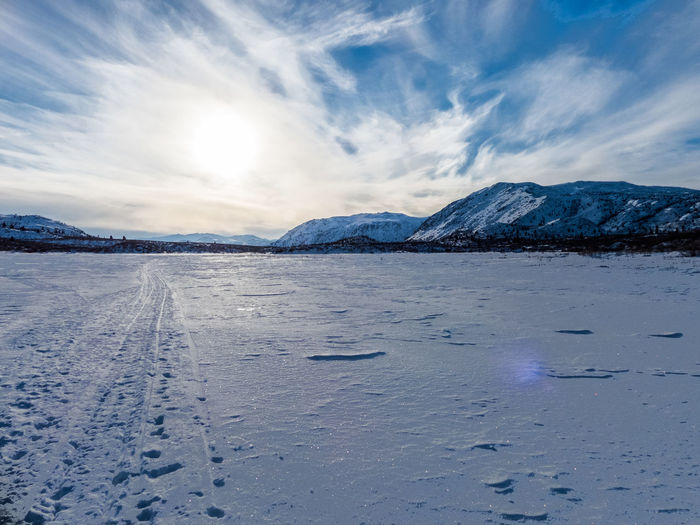 ice desert on Fish Lake Beauty In Nature Blue Canada Clods And Sky Clouds Cold Temperature Day Frozen Ice Ice Desert Landscape Landscape_Collection Landscape_photography Mountain Mountain Range Mountains And Sky Nature No People Outdoors Scenics Snow Wilderness Winter Yukon