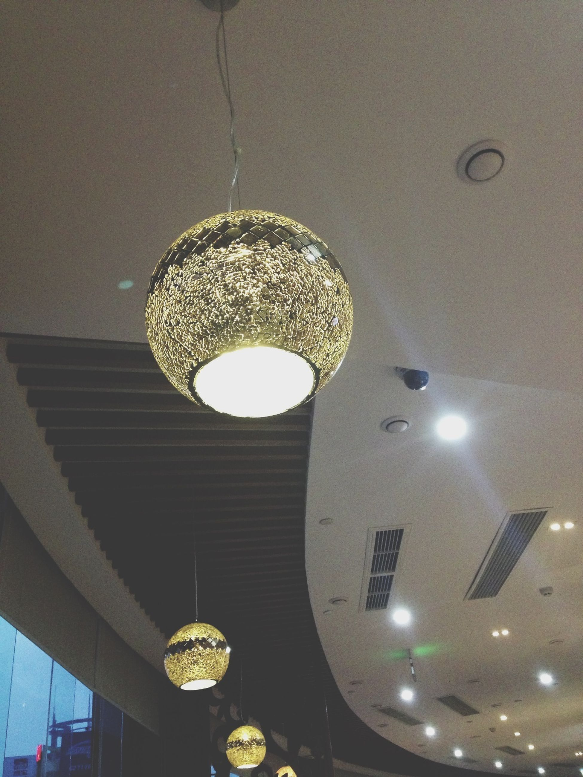illuminated, indoors, ceiling, lighting equipment, low angle view, hanging, electricity, electric lamp, electric light, chandelier, light bulb, decoration, pendant light, lamp, glowing, technology, light fixture, light - natural phenomenon, decor, home interior