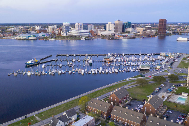 High angle view of harbor and buildings in city