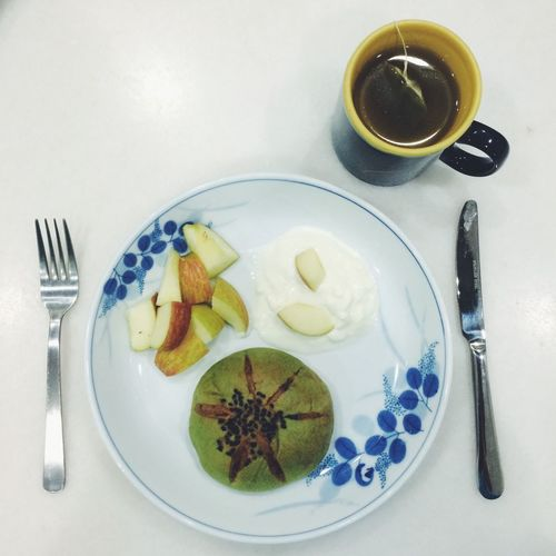 Fruits and green tea served on table