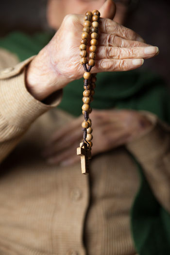 praying Cross Crown Crown Of Thorns Hands Pray Rosary Age Aged Close-up Grandma Grandmother Hand Holding Old Age Outdoors Prayer Praying