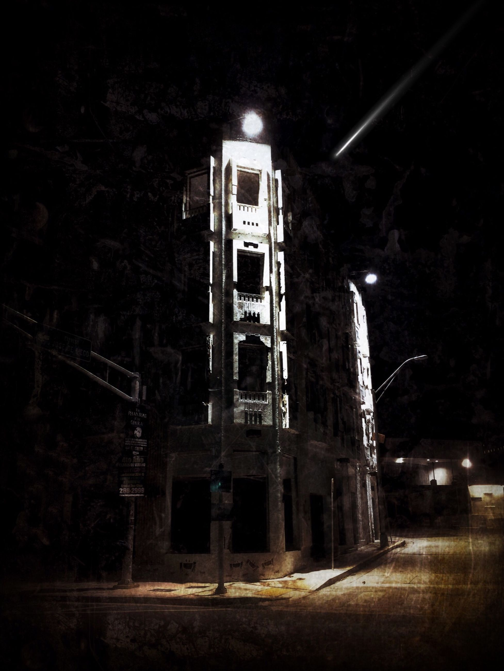 night, architecture, built structure, building exterior, illuminated, old, street light, street, outdoors, abandoned, low angle view, road, tree, transportation, lighting equipment, building, no people, dark, sky, house