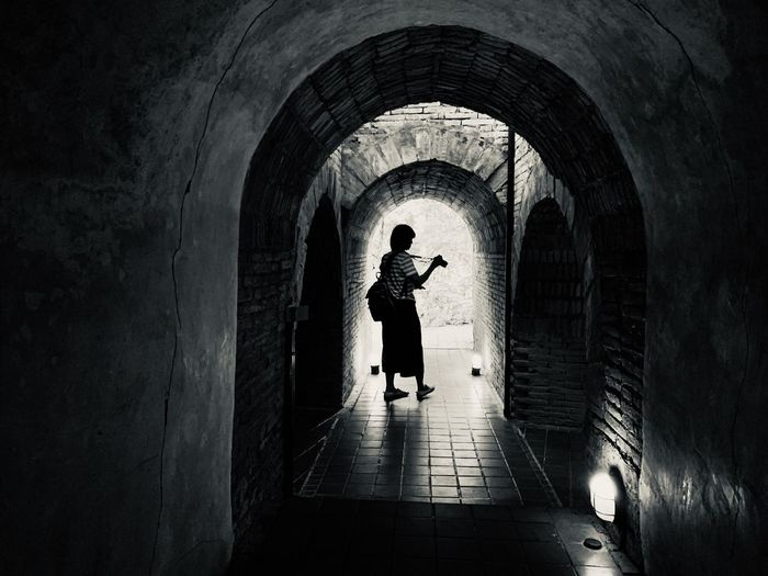 Woman walking in tunnel