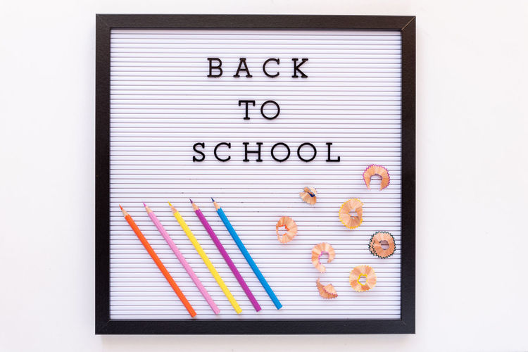 Back to school notice on message board Board Message White White Background Isolated School Education Class Pencil Pencil Drawing Indoors  Text No People Studio Shot Close-up Multi Colored Western Script Spiral Notebook Communication Choice Reminder Publication Paper Copy Space Large Group Of Objects Directly Above Creativity