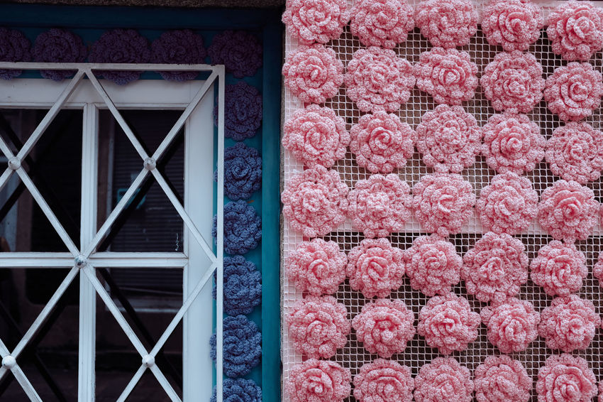 WOOL POWER Threeweeksgalicia Architecture No People Pink Color Wool Wool Balls Wooly Built Structure Building Exterior Building Window Day Meat Pattern Full Frame Red Close-up Outdoors Abundance Large Group Of Objects Freshness Brick Repetition Food And Drink