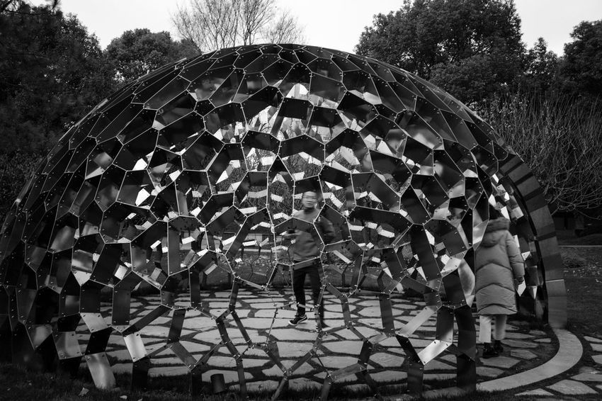 Tree Real People Day Plant Nature Leisure Activity Lifestyles Child People Men Outdoors Pattern Rear View Architecture Umbrella Shape Full Length Sky Childhood Beauty In Nature Blackandwhite Scupture LeicaM9