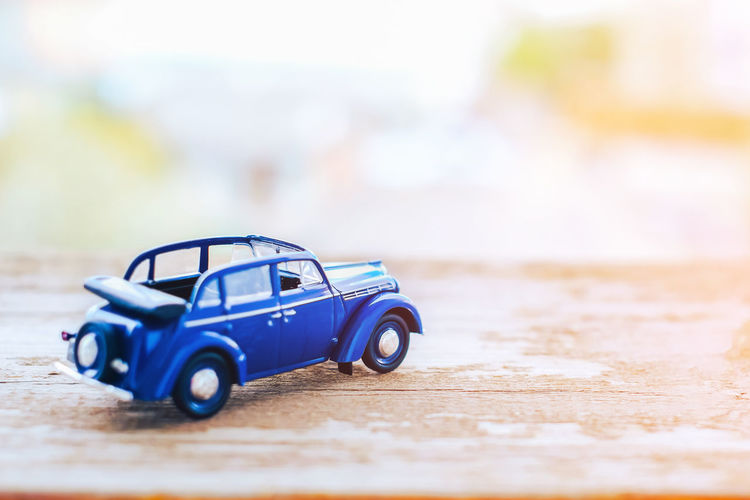 Toy Toy Car Car Blue Selective Focus Transportation Childhood Motor Vehicle Mode Of Transportation Table Close-up Indoors  Single Object Land Vehicle Plastic Day Flooring Offspring Wood - Material Small