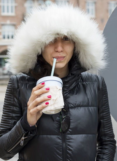 Portrait of a young woman drinking from a cardboard cup Caucasian, White Clothing Coffee - Drink Drink Drinking Food And Drink Front View Fur Holding Hood - Clothing Hot Drink Leisure Activity Lifestyles One Person Portrait Real People Refreshment Warm Clothing Winter Women Young Adult The Portraitist - 2018 EyeEm Awards