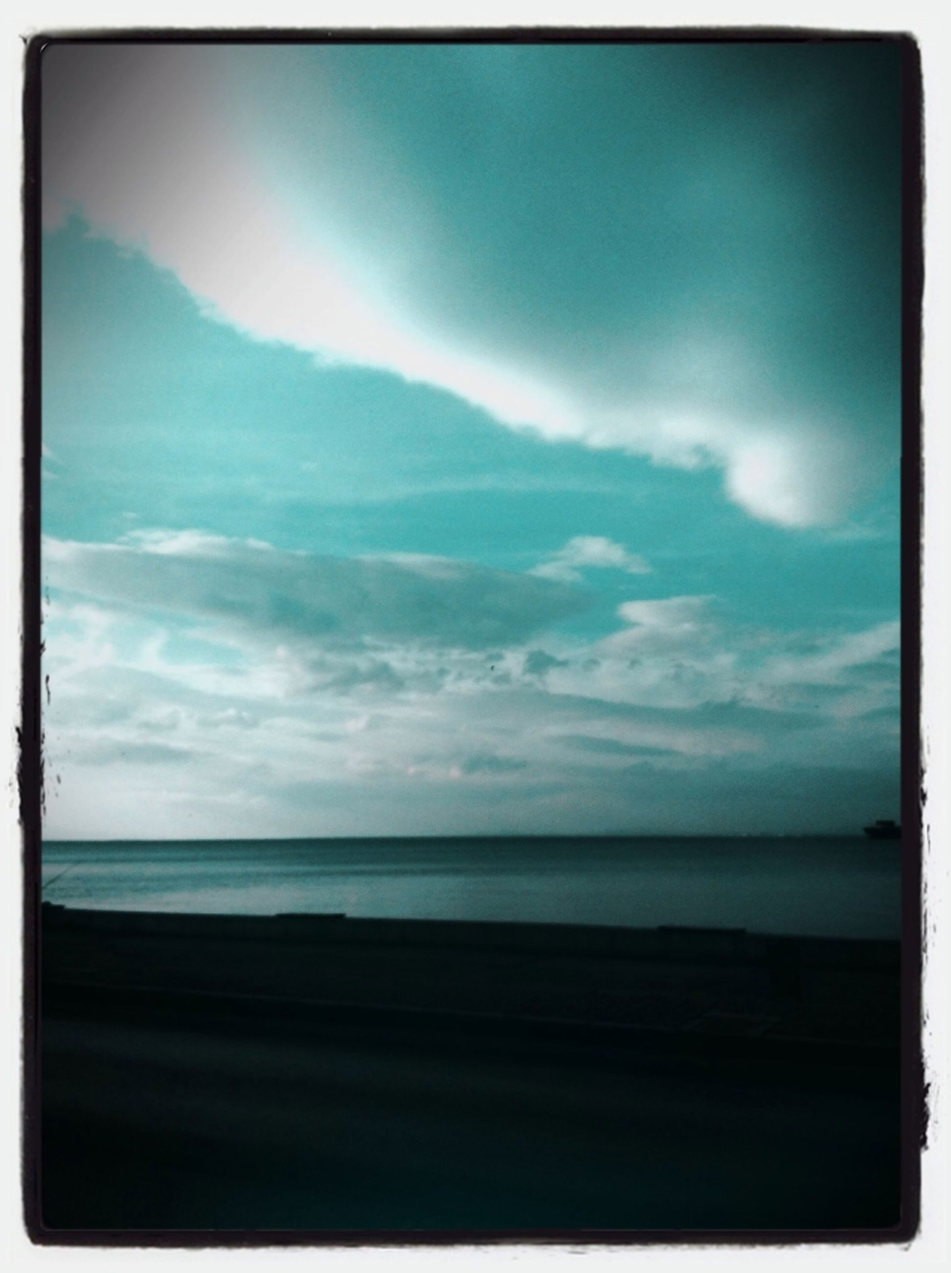 sea, horizon over water, transfer print, sky, tranquil scene, water, scenics, tranquility, beach, beauty in nature, auto post production filter, cloud - sky, nature, shore, cloud, idyllic, cloudy, blue, coastline, calm