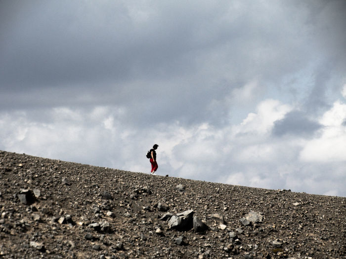 Silhouette of woman against cloudy sky
