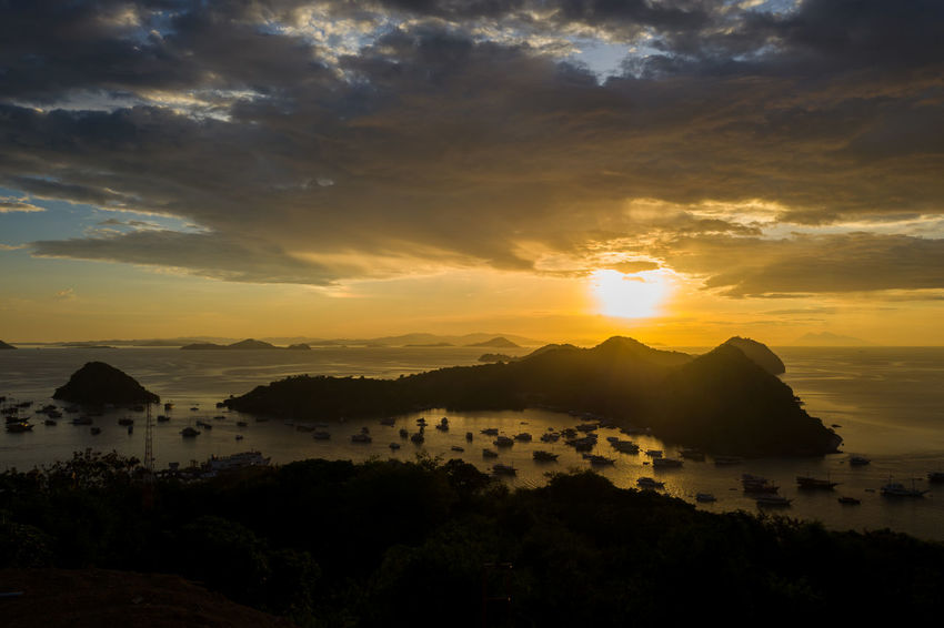 Labuan Bajo Sunset Beauty In Nature Cloud - Sky Environment Idyllic Landscape Mountain Nature No People Non-urban Scene Orange Color Outdoors Scenics - Nature Sky Sun Sunlight Sunset Tranquil Scene Tranquility Water