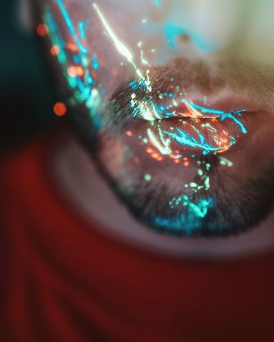 Close-up of lights on bearded man mouth