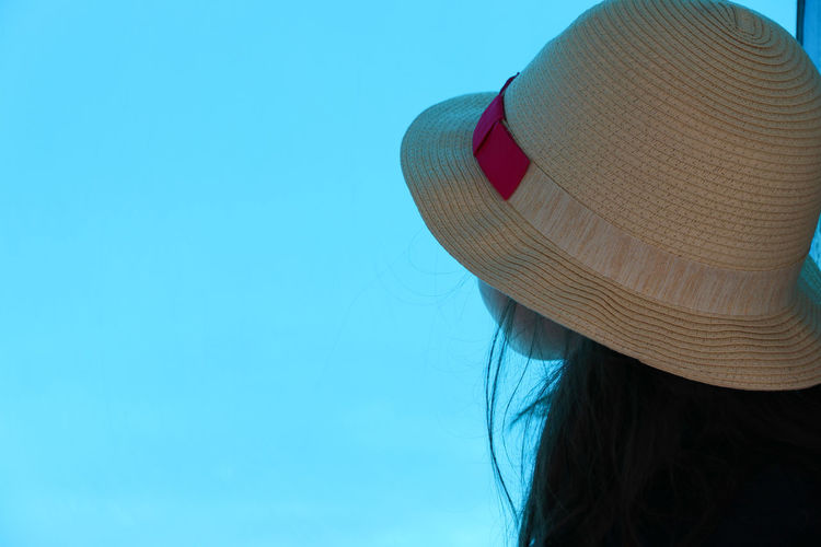Girl looking into the blue Adult Aquarium Blue Childhood Clear Sky Close-up Clothing Copy Space Day Hairstyle Hat Headshot Human Face Leisure Activity Lifestyles Nature Obscured Face One Person Portrait Real People Rear View Sky Summer Sun Hat The Portraitist - 2018 EyeEm Awards The Fashion Photographer - 2018 EyeEm Awards