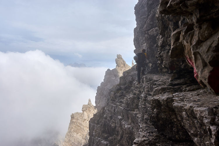 On the narrow ledge at the start of the normal route to Campanile Toro. Dolomites, Italy Mountaineering Rock Spalti Di Toro Adventure Climbing Clouds Go Higher Mountain One Person Outdoors Veneto