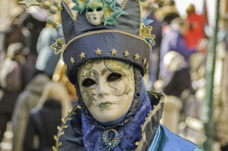 Portrait of a beautiful woman dressed as a blue wizard during the Venetian carnival party in San Marco square Carnival Colored Masque Square Tradition Venetian Wizard Blue Carneval Close-up Concealed Costume Disguise Dressing Hide Italy Mask Masquerade Mistery Party Portrait San Marco Traditional Unrecognizable Venice