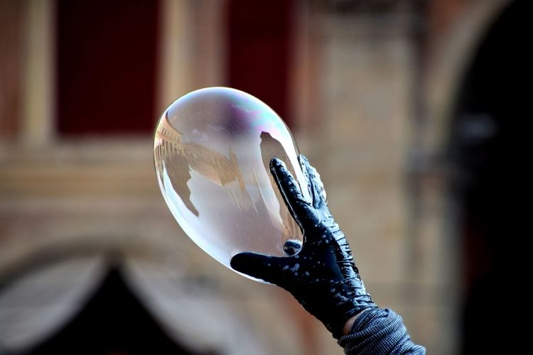 Close-up of hand holding bubble