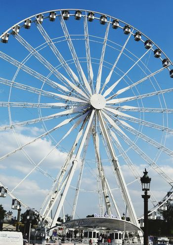 Panoramic wheel .Paris Amusement Park Arts Culture And Entertainment Ferris Wheel Low Angle View Outdoors Clear Sky Sky Travel Destinations Paris France EyeEm Gallery EyeEm Best Shots Tourism Travel 3XSPUnity Parigi Art Is Everywhere EyeEmNewHere Day Technology Lovefortravel Eyeemphotography Photography French Paris, France  The Street Photographer - 2017 EyeEm Awards Neighborhood Map Your Ticket To Europe The Week On EyeEm