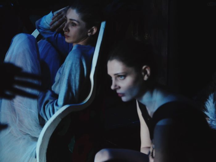 High angle view of women sitting in dark