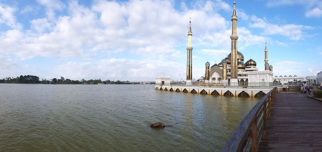 View of mosque against cloudy sky