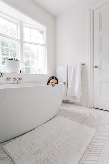 Place Of Heart Indoors  Home Interior One Person Young Adult Domestic Life Lifestyles Sitting Leisure Activity Relaxation Sofa Window Day Casual Clothing Full Length Young Women Built Structure Living Room Real People Architecture Portrait bath bathroom tub
