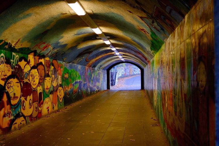 Direction The Way Forward Architecture Graffiti Tunnel Indoors  Multi Colored Built Structure Illuminated Footpath Creativity Light At The End Of The Tunnel