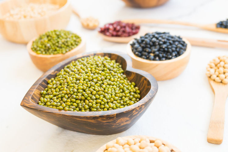 Close-up of various beans over white background
