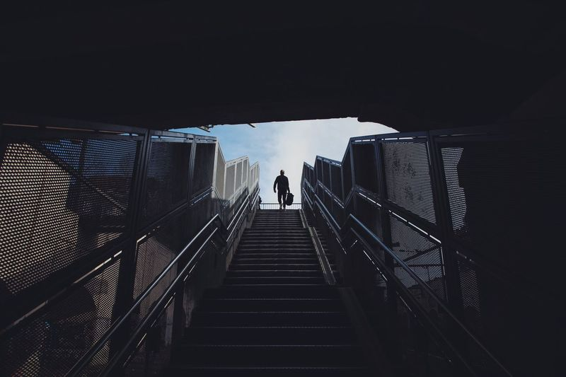 Low angle view of man moving on steps