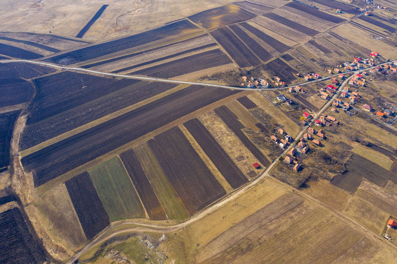 Aerial view of a village and countryside road, drone shot High Angle View Landscape Aerial View Nature Environment Outdoors Scenics - Nature Day Road Drone  Dronephotography Drone Photography Droneshot Aerial Aerial Photography Aerial Shot Aerial Landscape Village Transylvania Romania Arable Field Agriculture Plowing The Fields Spring