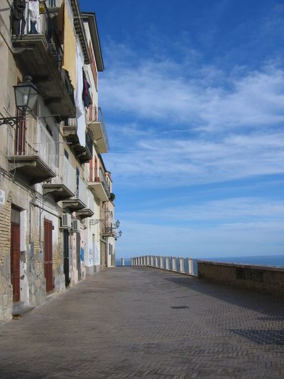 Street Italy Vasto Non People Graffiti Horizon Travel Destinations Holiday Wintertime Sea In Winter Sea On The Right Sunny Day White Clouds Balconys Blue Sky Building Exterior Buildings On The Left Doors Sky And Clouds Standing Linens Calm Seascape Idyllic Tranquility Tranquil Scene Scenics Horizon Over Water Remote Coast