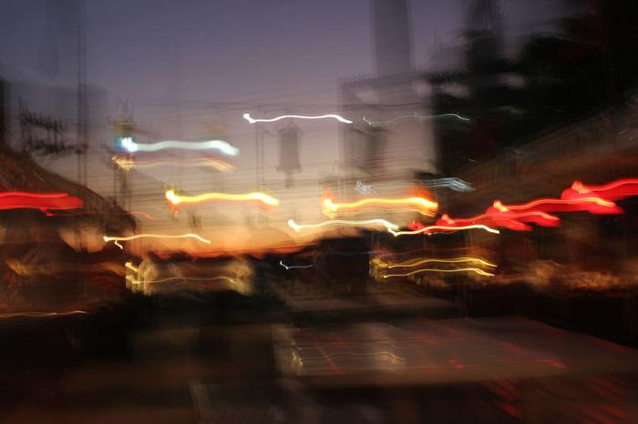 Architecture Blurred Motion City City Life Eye For Photography EyeEm Best Shots EyeEm City Shots EyeEm Gallery EyeEm Technology EyeEmBestPics EyeEmNewHere Illuminated Motion Night Nightlife Outdoors Sky Technology AI Now