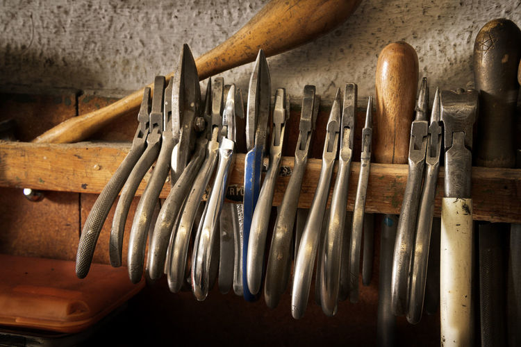 different goldsmiths pliers and tools on the jewelry workplace Creativity Objects Workplace Art And Craft Goldsmith Hanging Indoors  Jeweller Jewelry Large Group Of Objects No People Occupation Old Pliers Still Life Tool Vintage Wood - Material Work Tool