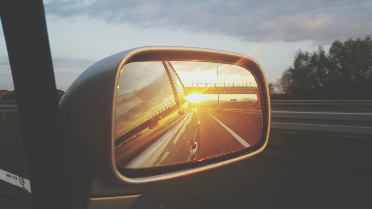 transportation, car, side-view mirror, mode of transport, sun, sky, lens flare, land vehicle, sunlight, sunset, sunbeam, road trip, travel, journey, road, no people, cloud - sky, speed, vehicle mirror, nature, outdoors, day, close-up