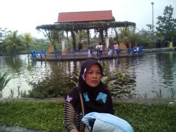 bale kemambang Water Portrait People Lake Reflection One Person Tree Child Sitting Childhood Children Only Boys Looking At Camera Outdoors Elementary Age Day Grass One Boy Only Males  Building Exterior