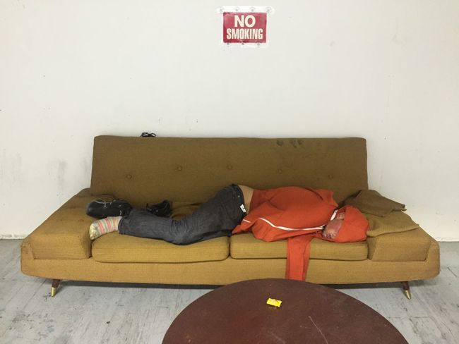 Found this guy passed out on the couch in the common area of my artist studio. Tried to wake him up, but ended up just letting him sleep. I also poured him a glass of water. He drank the water and left 5 hours later. 1960's 1970s Couch Couchsurfing Drugs Drunk Exhausted Hangover Homeless No Smoking Passed Out Relaxation Sad Sleeping Tired Wall Warehouse Yellow